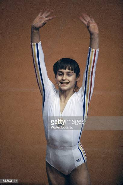 Gymnastics 1976 Summer Olympics ROM Nadia Comaneci victorious during competition Montreal CAN 7/17/19768/1/1976