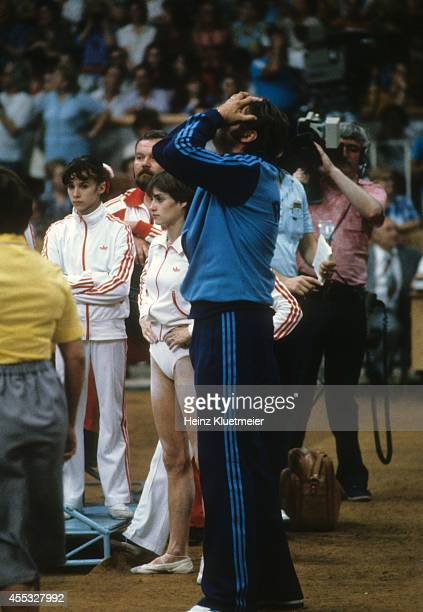 1980 Summer Olympics View of Romania Nadia Comaneci and coach Bela Karolyi upset after results are announced during Women's event at Sports Palace of...