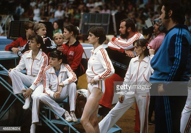 1980 Summer Olympics View of Romania Nadia Comaneci and coach Bela Karolyi awaiting results during Women's event at Sports Palace of the Central...
