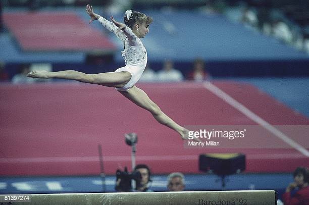 Gymnastics 1992 Summer Olympics USA Shannon Miller in balance beam action during competition Barcelona ESP 8/1/1992