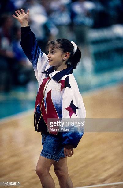 1996 Summer Olympics USA Dominique Moceanu victorious after winning gold during Women's AllAround team competition at Georgia Dome Atlanta GA CREDIT...