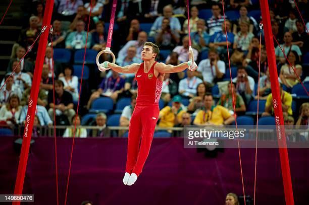 2012 Summer Olympics Russia David Belyavskiy in action still rings during Men's Individual AllAround Final at North Greenwich Arena London United...