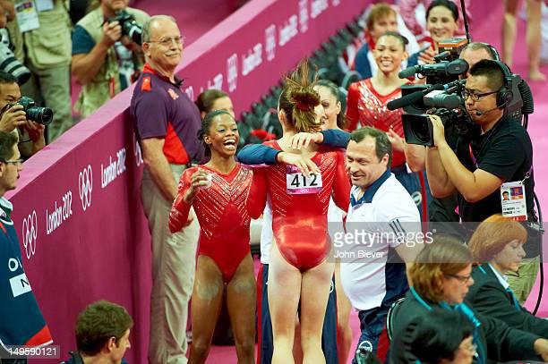 2012 Summer Olympics Team USA Gabrielle Douglas Alexandra Raisman McKayla Maroney and Jordyn Wieber victorious during celebration after winning...