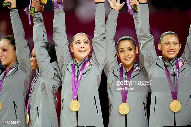 2012 Summer Olympics Team USA Jordyn Wieber Gabrielle Douglas McKayla Maroney Alexandra Raisman and Kyla Ross victorious on medal stand after winning...