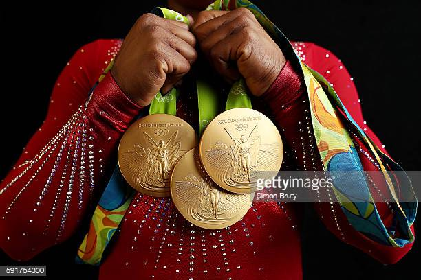 2016 Summer Olympics Closeup portrait of Team USA gymnast Simone Biles holding 4 Gold medals and 1 Bronze medal during photo shoot at Main Press...
