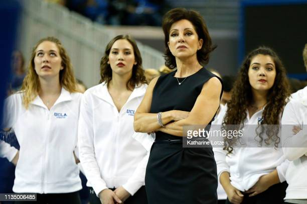 UCLA gymnastics head coach Valorie KondosField watches athletes compete on balance beam during a meet against Stanford at Pauley Pavilion on March 10...