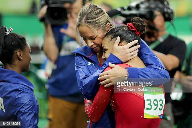 Day 10 Coach Maggie Haney congratulates Lauren Hernandez of the United States after performing her routine which won her the silver n medal in the...