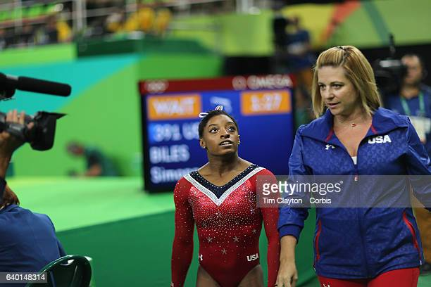 Day 10 Simone Biles of the United States is congratulated by her coach Aimee Boorman after performing her routine in the Women's Balance Beam Final...