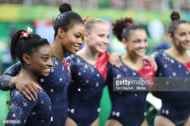 Day 2 The United States team of Simone Biles Gabrielle Douglas Madison Kocian Lauren Hernandez and Alexandra Raisman after the Artistic Gymnastics...