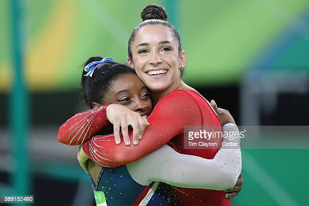 Day 6 Simone Biles of the United State and Alexandra Raisman of the United States embrace as the final result come through confirm Gold and Silver...