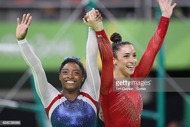 Day 6 Simone Biles of the United State and Alexandra Raisman of the United States embrace as the final result comes through confirming Gold and...