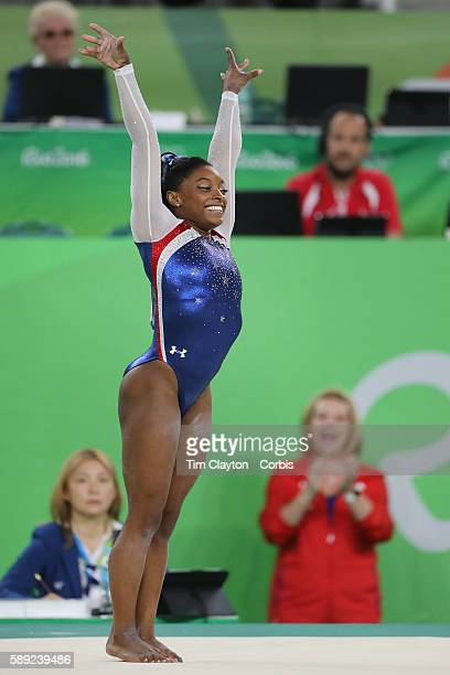 Day 6 Simone Biles of the United States performs her routine on the floor watched by her delighted coach Aimee Boorman during the Artistic Gymnastics...