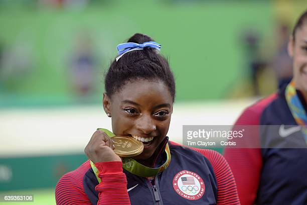 Day 6 Simone Biles of the United States with her gold medal in the Artistic Gymnastics Women's Individual AllAround Final at the Rio Olympic Arena on...