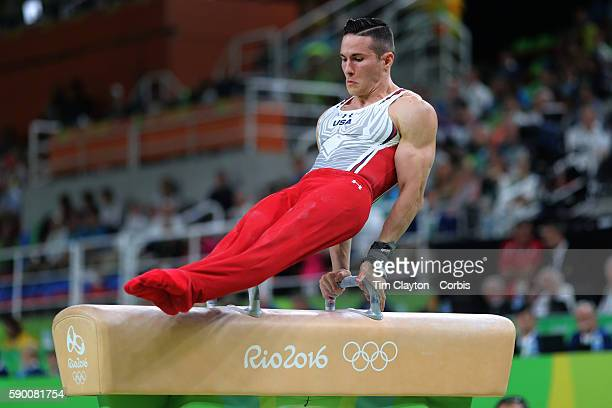Day 9 Alexander Naddour of the United States performs his routine in the Men's Pommel Horse Final to win the bronze medal at the Rio Olympic Arena on...