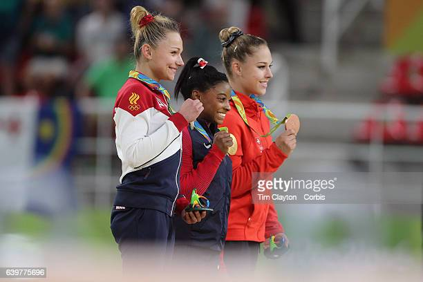 Gymnastics - Olympics: Day 9 Gold medal winner Simone Biles of the United States with silver medalist Maria Paseka of Russia and bronze medalist...