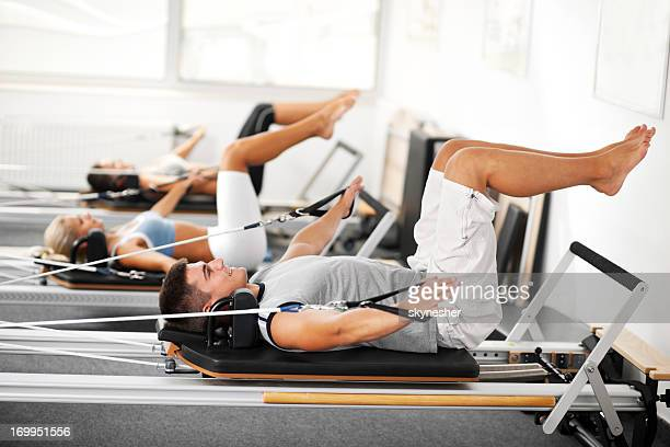 gymnastics pilates - human arm stock pictures, royalty-free photos & images