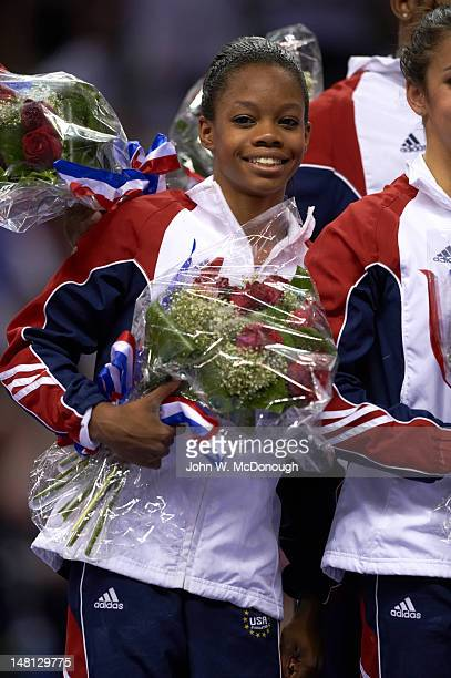 US Olympic Trials Gabrielle Douglas victorious with floral bouquet after Women's competition at HP Pavilion San Jose CA CREDIT John W McDonough