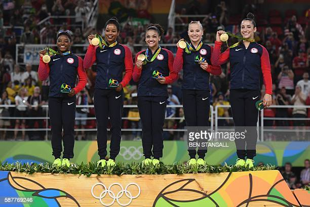 US gymnasts Alexandra Raisman Madison Kocian Lauren Hernandez Gabrielle Douglas and Simone Biles celebrate with their gold medals on the podium...