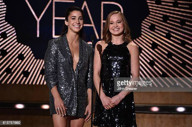Gymnasts Aly Raisman and Madison Kocian present an award on stage at CMT Artists of the Year 2016 on October 19 2016 in Nashville Tennessee