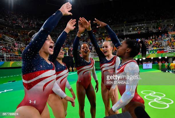 TOPSHOT US gymnasts celebrate after the women's team final Artistic Gymnastics at the Olympic Arena during the Rio 2016 Olympic Games in Rio de...
