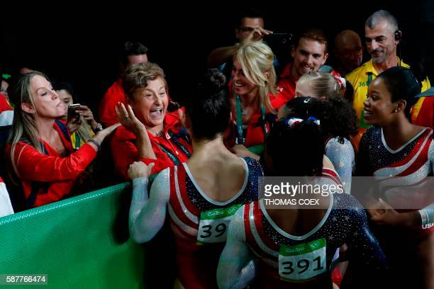TOPSHOT US gymnasts celebrate with their families after the women's team final Artistic Gymnastics at the Olympic Arena during the Rio 2016 Olympic...