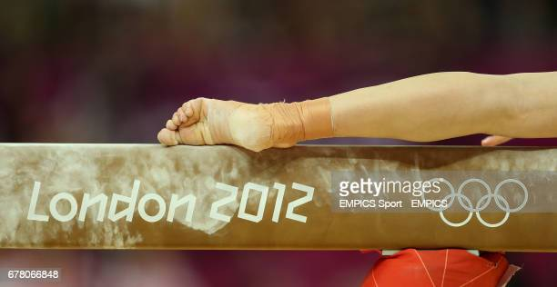 A gymnasts foot balances on the high beam at the North Greenwich Arena London during day four of the London 2012 Olympics