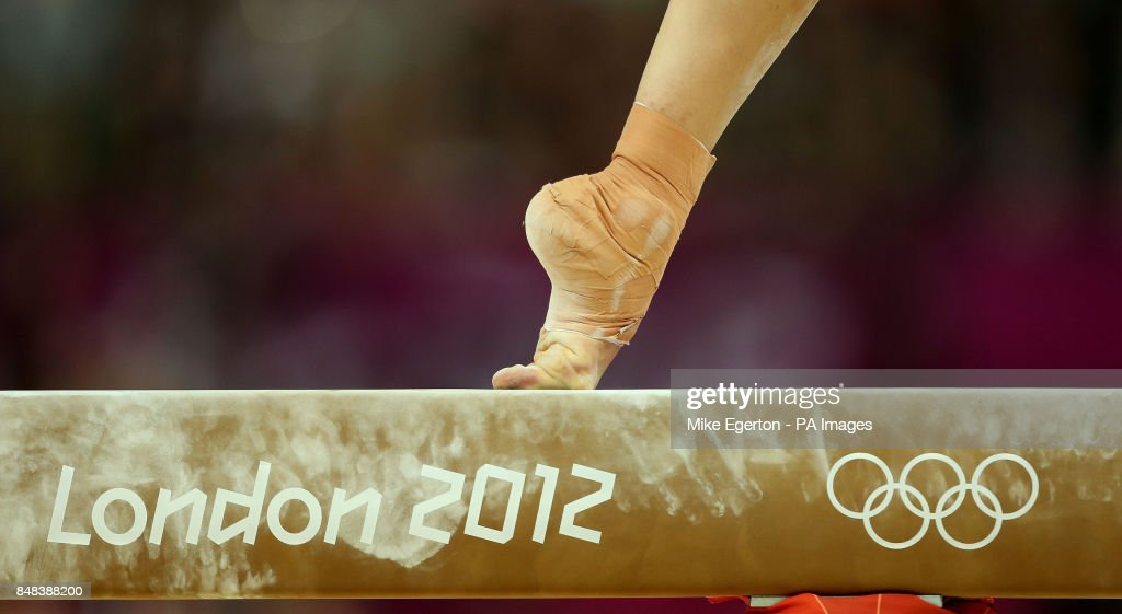 A Gymnasts Foot Balances On The High Beam During Artistic Gymnastics Womens Team Final At