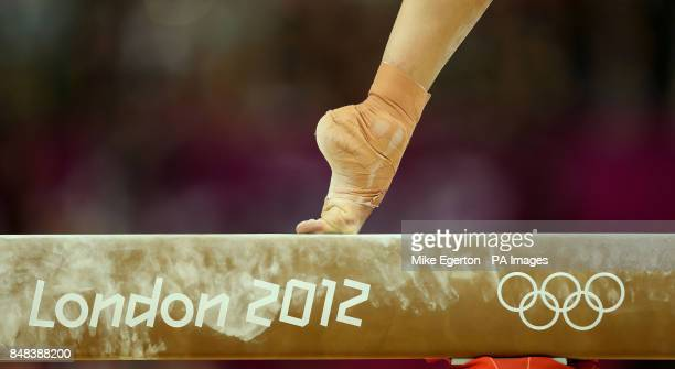 A gymnasts foot balances on the high beam during the Artistic Gymnastics Women's Team Final at the North Greenwich Arena during the fourth day of the...