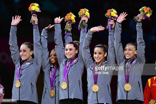 USA gymnasts from left Jordan Wieber Gabrielle Douglas Mc Kayla Maroney Alexandra Raisman and Kyla Ross celebrate their gold medal in Women's Team...