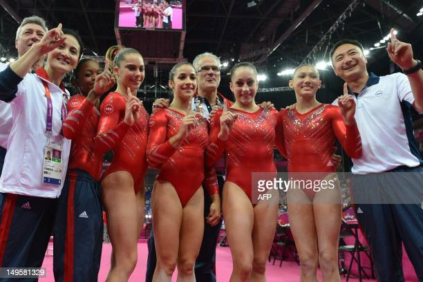 US gymnasts Gabrielle Douglas Mckayla Maroney Alexandra Raisman coach John Geddert Jordyn Wieber and Kyla Ross celebrate winning gold in the women's...