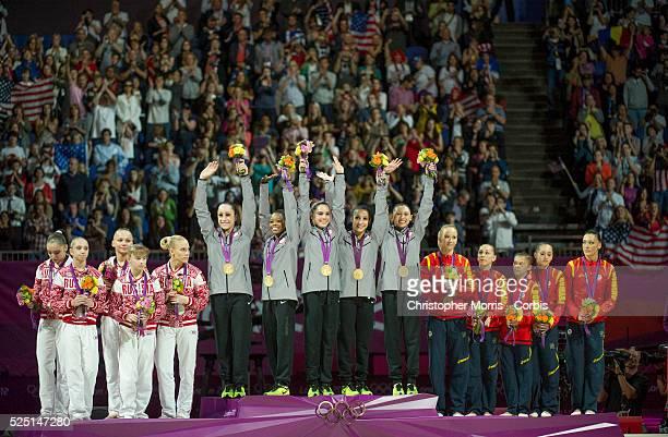US gymnasts left to right Jordyn Wieber Gabrielle Douglas McKayla Maroney Alexandra Raisman and Kyla Ross on the podium during the medal ceremony...