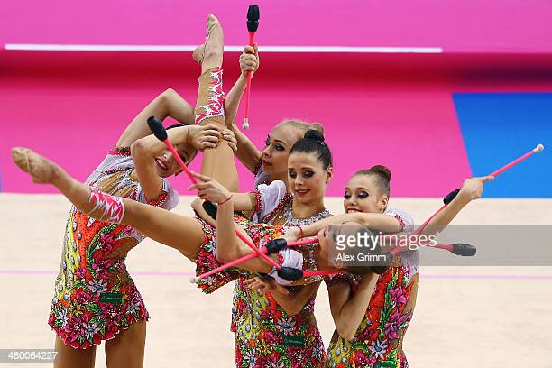 Gymnasts of the team of Russia perform during the group allarround competition of the GAZPROM World Cup Rhythmic Gymnastics at Porsche Arena on March...