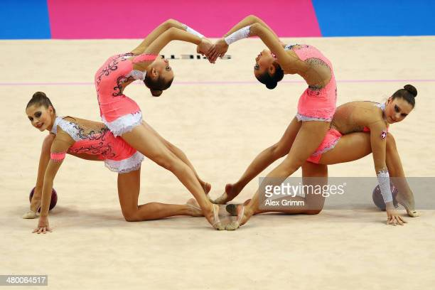 Gymnasts of the team of Switzerland perform during the group allarround competition of the GAZPROM World Cup Rhythmic Gymnastics at Porsche Arena on...