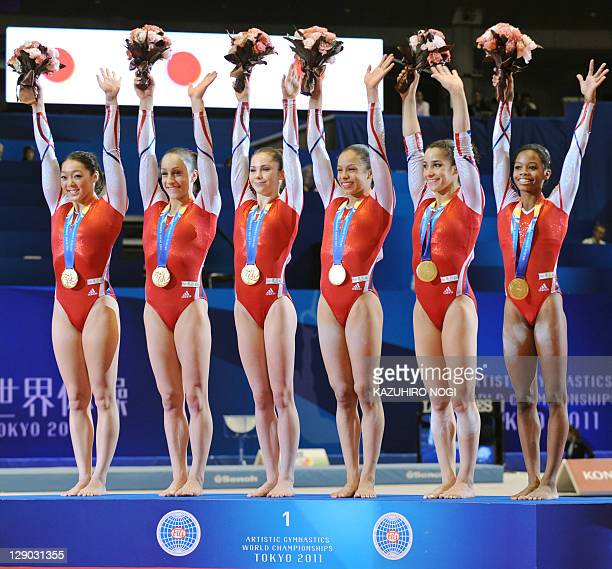 Gymnasts of the US celebrate their win during the awards ceremony for the women's team event final at the World Gymnastics Championships in Tokyo on...