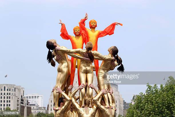 Gymnasts perform during the London2012 Olympic Torch Relay Photocall at the Queen Elizabeth Hall terrace on May 26 2010 in London England