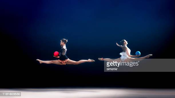 gymnasts performing with balls - rhythmic gymnastics stock pictures, royalty-free photos & images