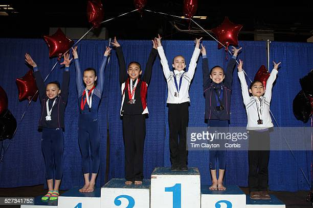 Gymnasts salute after receiving their medals during the 21st American Invitational 2014 competition at the XL Centre Hartford Connecticut USA USA...