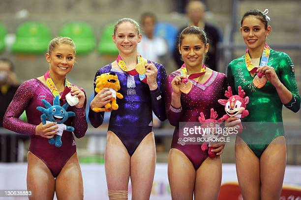 Gymnasts Shaw Johnson and Bridgette Calquatto of the USA and Elsa Garcia and Marisela Cantu both from Mexico and with tied score pose on the podium...