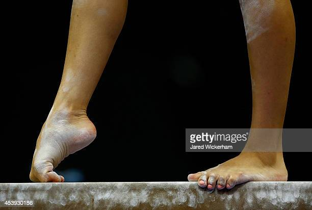 Gymnasts warm up on the balance beam prior to competing in the senior women preliminaries during the 2014 PG Gymnastics Championships at Consol...