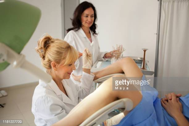 gynaecologist examining a patient - pap smear stock photos and pictures