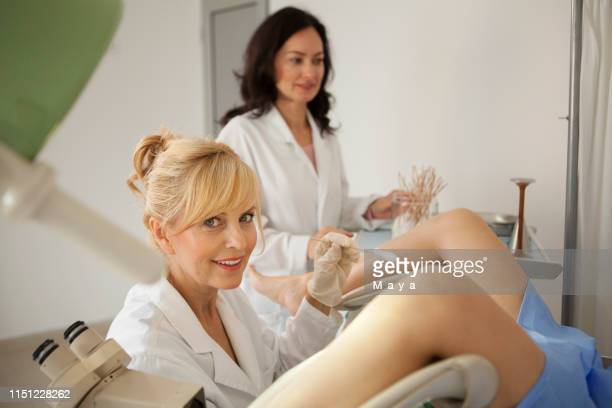 gynaecologist examining a patient - pap smear stock pictures, royalty-free photos & images
