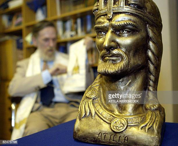 Gyoergy Kisfaludy leader of the Hungarian Hun minority and hierarch of their community 'Church of Universum' sits beside a bust of Attila the Hun at...