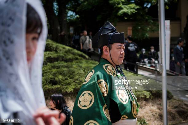 Gyoji waits during 'Honozumo' ceremonial on April 16, 2018 in Tokyo, Japan. This annual offering of a Sumo Tournament to the divine at the Yasukuni...