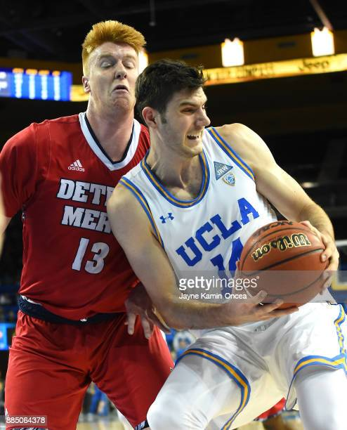 Gyorgy Goloman of the UCLA Bruins and Jack Ballantyne of the Detroit Mercy Titans battle for a rebound in the second half of the game at Pauley...