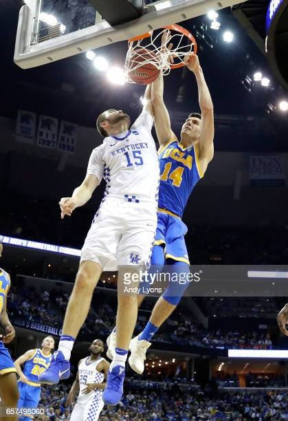 Gyorgy Goloman of the UCLA Bruins dunks on Isaac Humphries of the Kentucky Wildcats in the first half during the 2017 NCAA Men's Basketball...