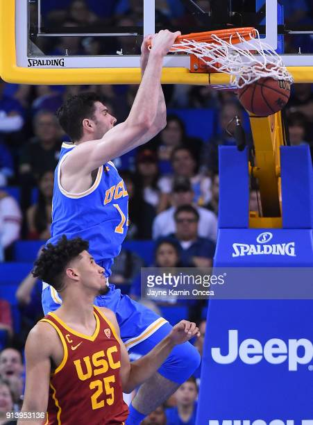 Gyorgy Goloman of the UCLA Bruins dunks over Bennie Boatwright of the USC Trojans in the second half at Pauley Pavilion on February 3 2018 in Los...