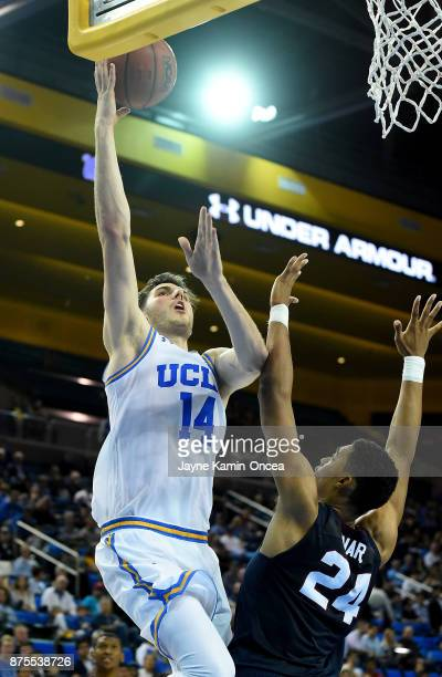 Gyorgy Goloman of the UCLA Bruins goes for a layup over Ian Kinard of the South Carolina State Bulldogs in the second half of the game at Pauley...
