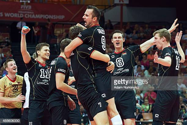 Gyorgy Grozer of Germany celebrates winning the point and the match with his teammates during the FIVB World Championships match between Germany and...