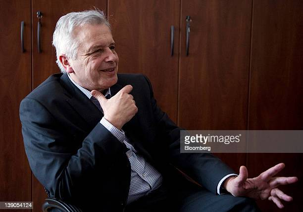 Gyorgy Kocziszky a member of the monetary council at the Magyar Nemzeti Bank Hungary's central bank gestures during an interview inside the bank's...