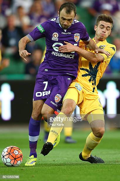 Gyorgy Sandor of the Glory and Liam Rose of the Mariners contest for the ball during the round 10 ALeague match between the Perth Glory and the...